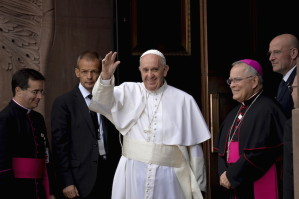 Pope Francis waves to the crowd as he arrives for mass at the Basilica of St. Peter and Paul, in Philadelphia, Pennsylvania